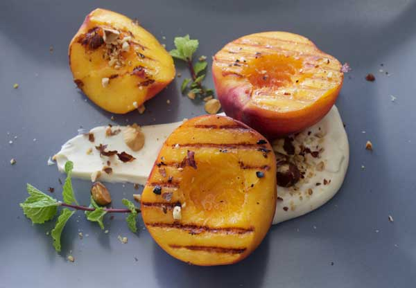 Grilled peaches with vanilla maple yoghurt & toasted hazelnuts