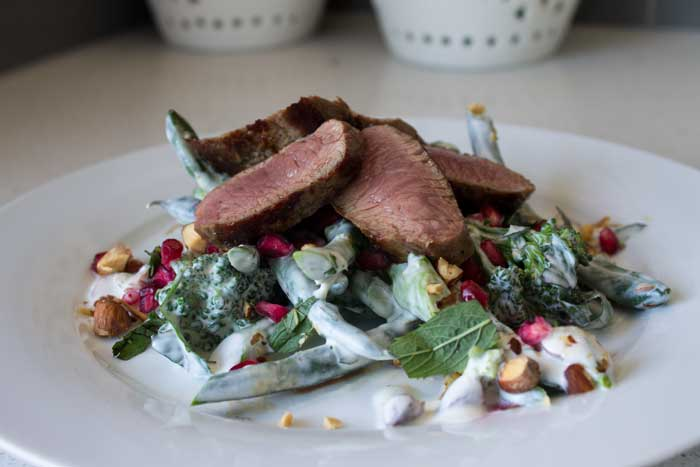 Lamb with bean & broccolini salad and tahini dressing.