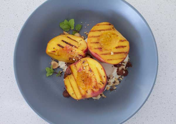 Grilled peaches with vanilla maple yoghurt and toasted hazelnuts